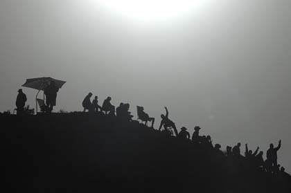 Spectators, silhoutte in sun